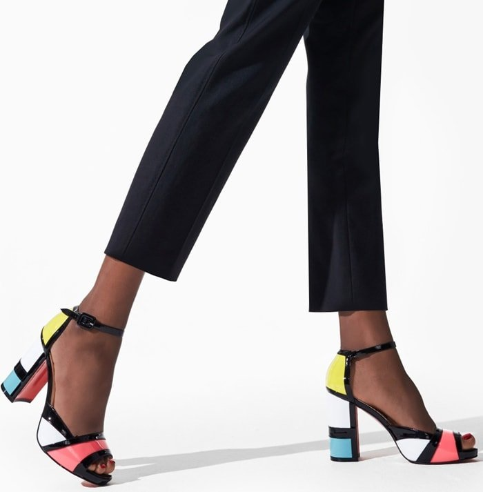 Evoking the modernist charm of a Mondrian-style painting, these peep-toe sandals feature bold colorblocking in glossy patent leather