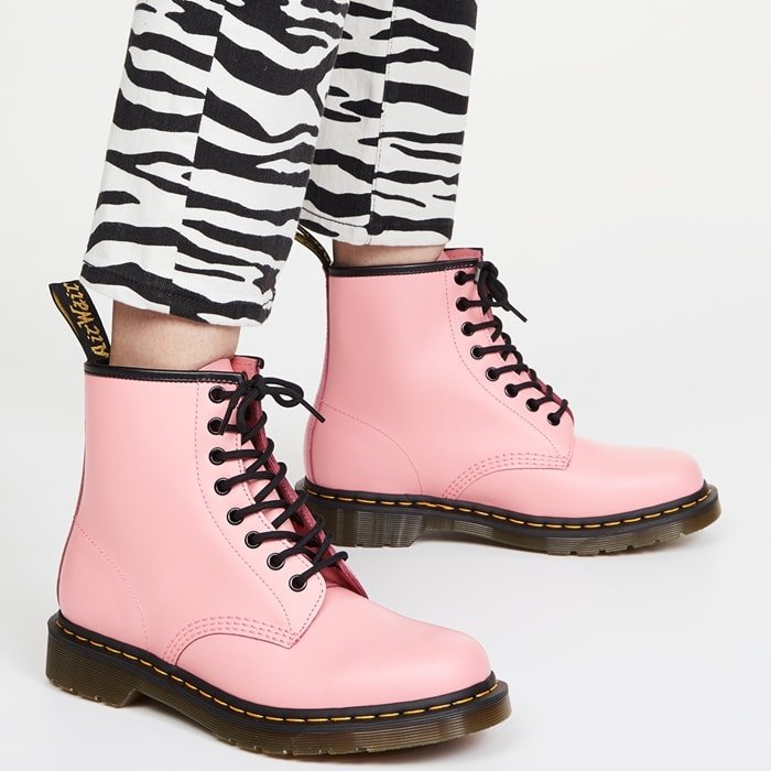 Statement skinny jeans with a bold zebra motif worn with pink Doc Martens