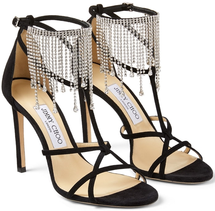 These black evening sandals are crafted in Italy from suede with slender straps and have a signature beige lining and sole