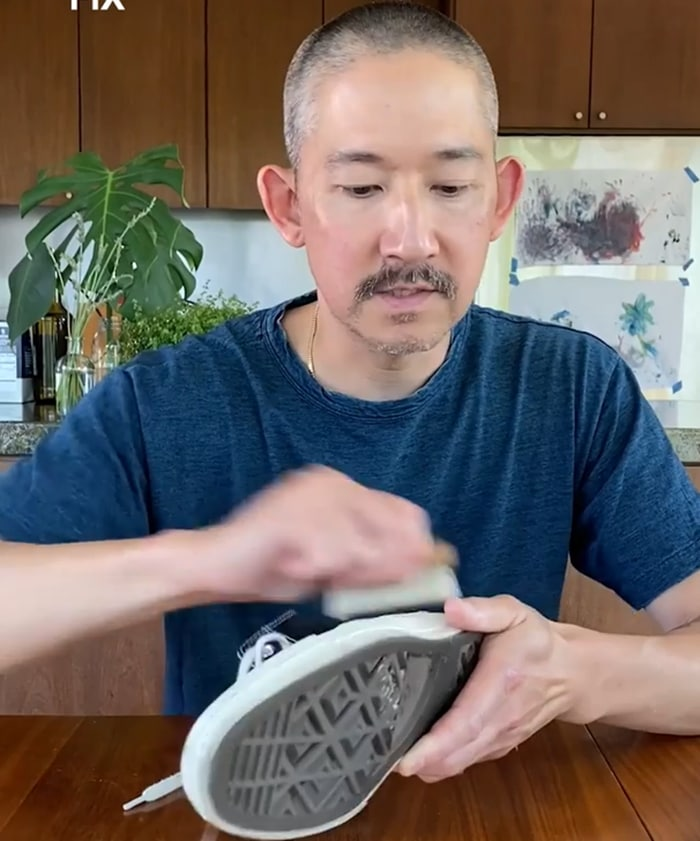 Jason Markk uses a soft-bristle brush to remove dust and surface dirt