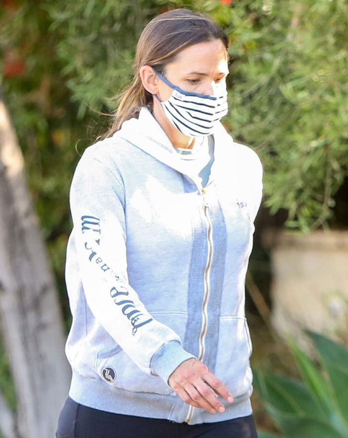 Jennifer Garner wears a hoodie from Once Upon a Farm, an organic baby food company she founded in 2017 in partnership with Cassandra Curtis, Ari Raz, and former Annie's president John Foraker