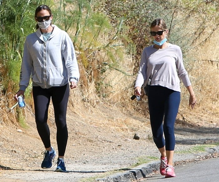 Jennifer Garner wears a protective face mask while out for a walk with a friend in Los Angeles