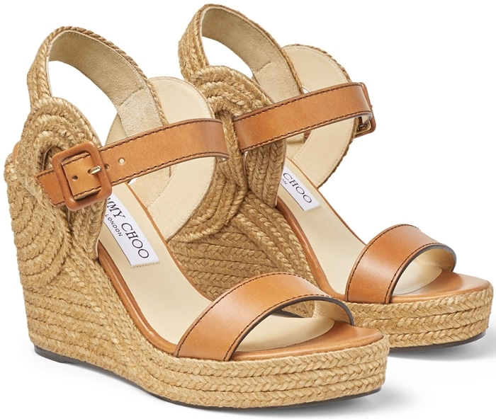 Sinuous loops of braided jute trim provide an unexpected twist on espadrille style for this summery sandal elevated by a lofty wedge heel