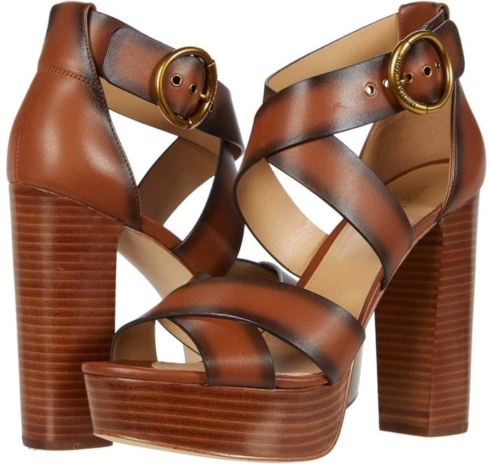 Wide crisscross straps and a retro-inspired platform heel elevate dressy looks with a vintage feel in the Leia sandals from Michael Michael Kors