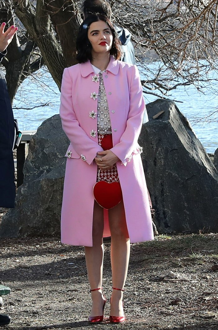 Lucy Hale in Dolce & Gabbana pink coat, Alice + Olivia embellished top, and Valentino Garavani Tango pumps February 4, 2020