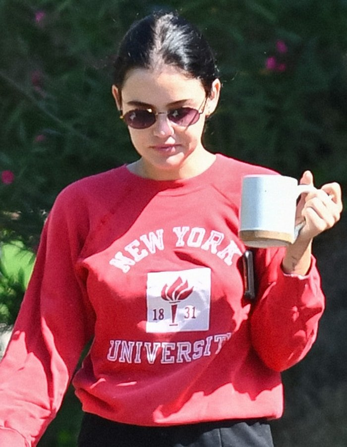 Lucy Hale steps out in red NYU sweatshirt and skips wearing a face mask