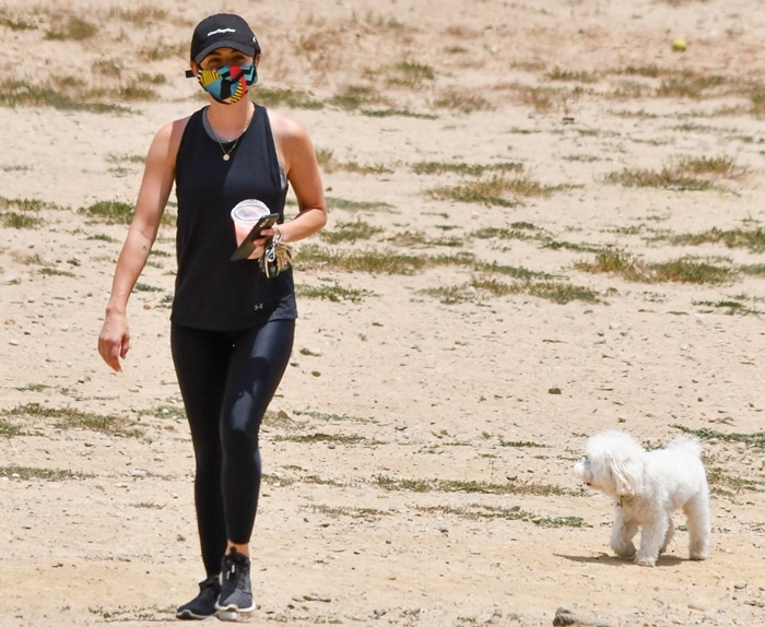 Lucy Hale wears Adidas women's Edge Lux 3 running shoes while hiking with her dog