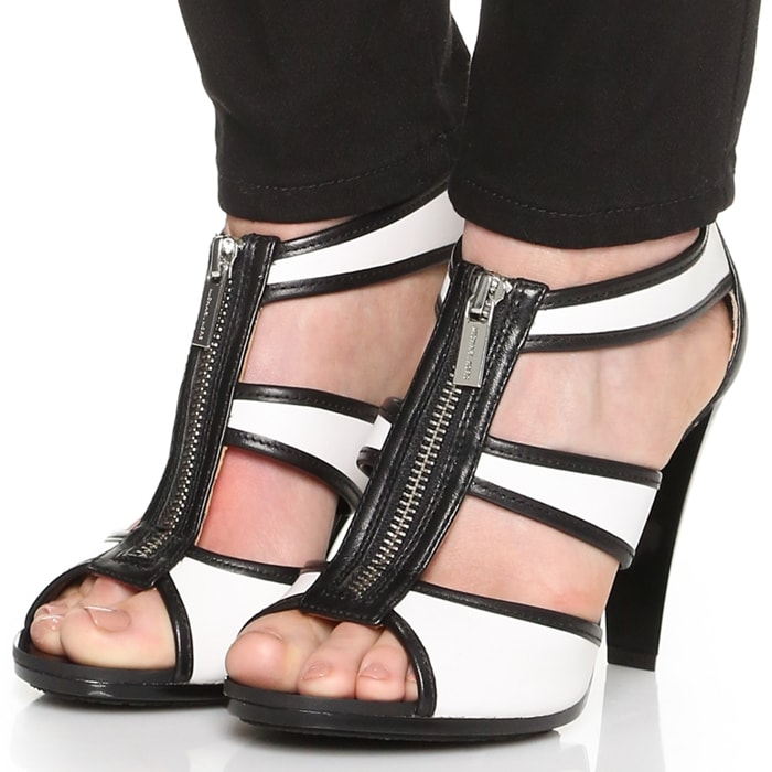 Elevated by a sleek platform and chunky heel, this zip-front style makes a timeless statement in smooth leather