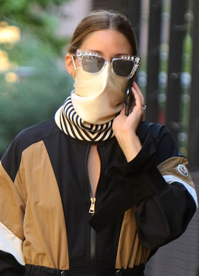 Olivia Palermo styles her look with Jimmy Choo bedazzled sunglasses and Le Scarf scarf