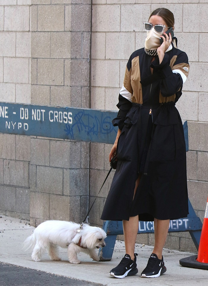 Olivia Palermo wears a black Moncler Zinzolin parka coat for her afternoon walk