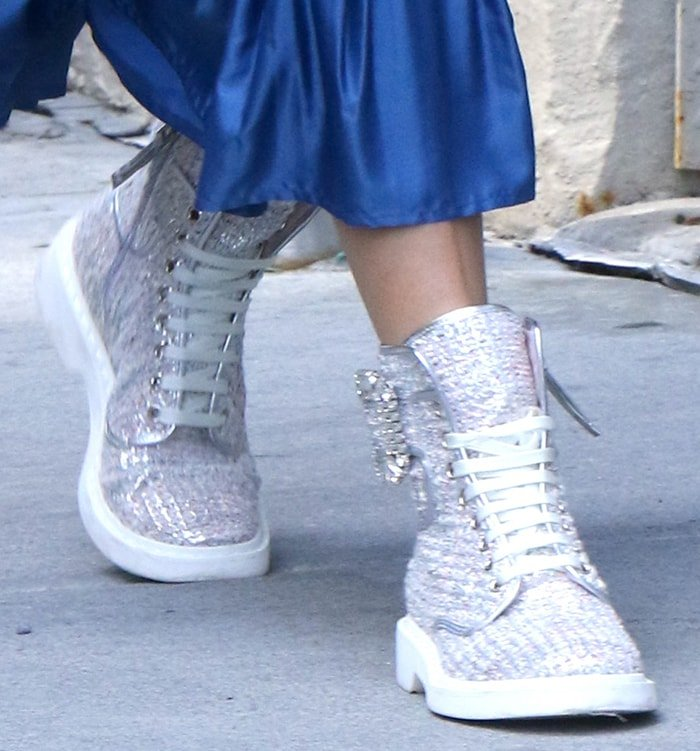 Olivia Palermo completes her eclectic ensemble with Roger Vivier silver tweed lace-up boots