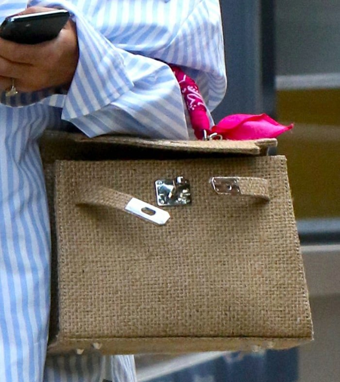 Olivia Palermo totes a Two Friends bag with pink bandana handle
