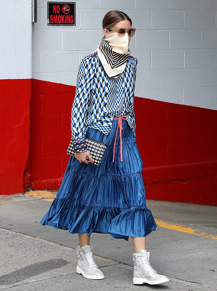 Olivia Palermo adds more pattern to her look with a black-and-white purse