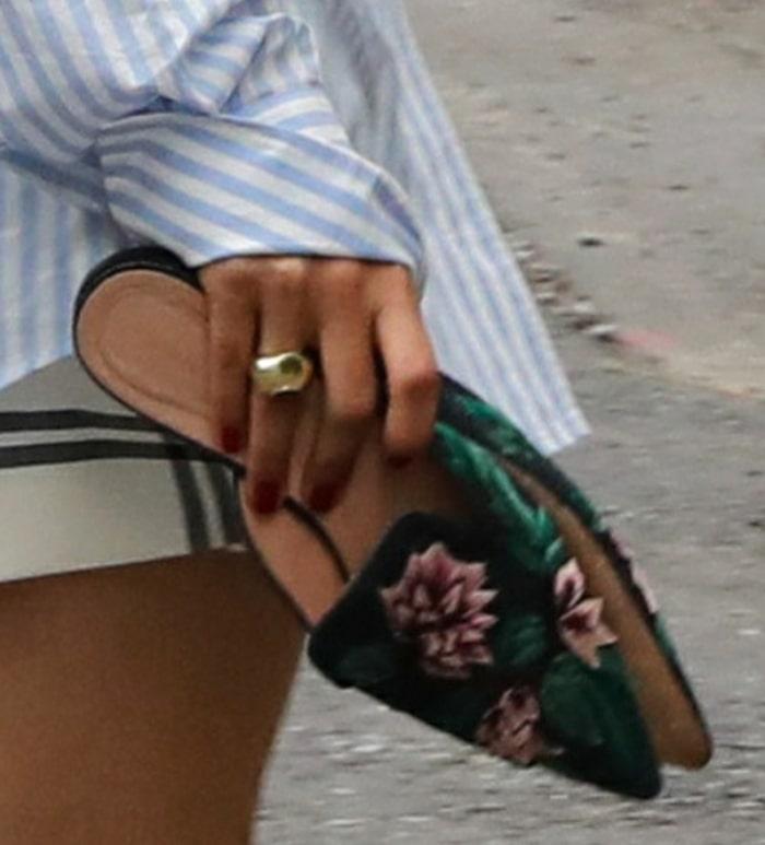 Olivia Palermo carries her Alberta Ferretti mules after having a pedicure