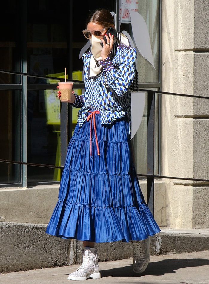 Olivia Palermo steps out in a Max & Co. maxi skirt to get her coffee