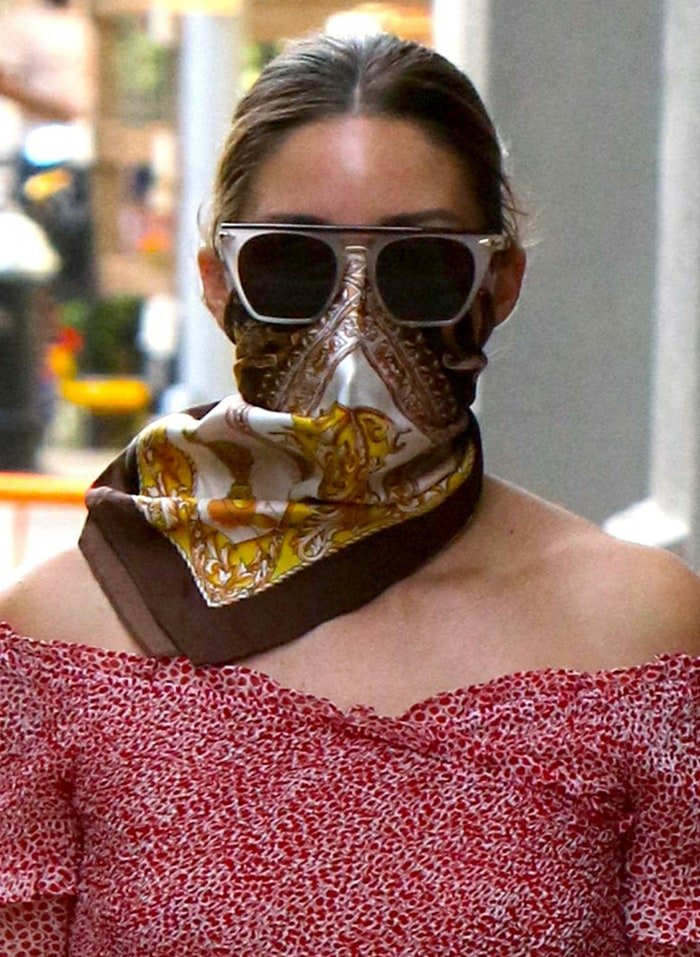 Olivia Palermo accessorizes with a printed scarf and her favorite sunglasses