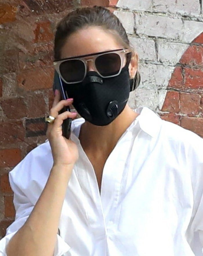 Olivia Palermo wears her favorite sunnies with a black face mask