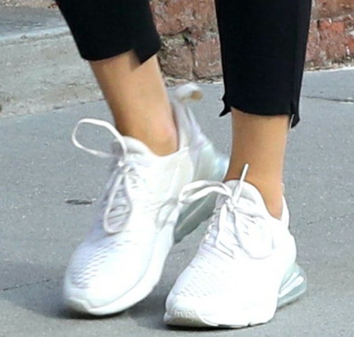 Olivia Palermo completes her laid-back outfit with Nike shoes