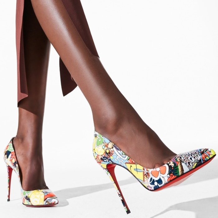 A whimsical rendering of the designer lost in the wonderland of his atelier patterns this chic calfskin pump set on a daring stiletto and that iconic red sole