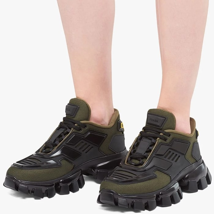 Crafted from a military green technical fabric upper and black three-dimensional injected rubber eyestay elements, these Cloudbust Thunder sneakers feature a round toe, a lace-up front fastening, a logo patch at the tongue, branded heel counter and a Sawtooth rubber sole