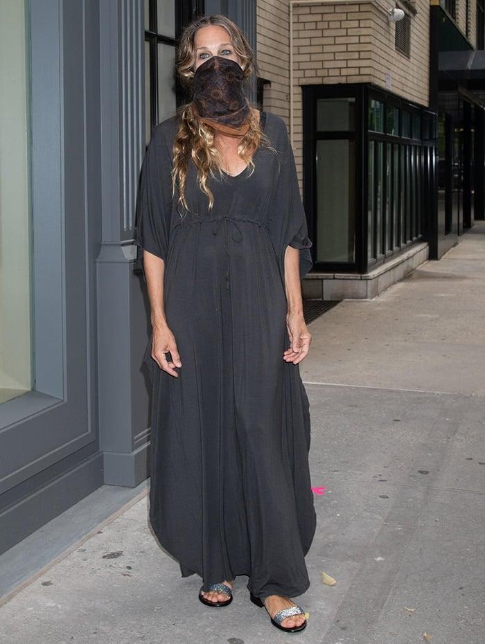 Sarah Jessica Parker slips into a charcoal-colored boho-style maxi dress
