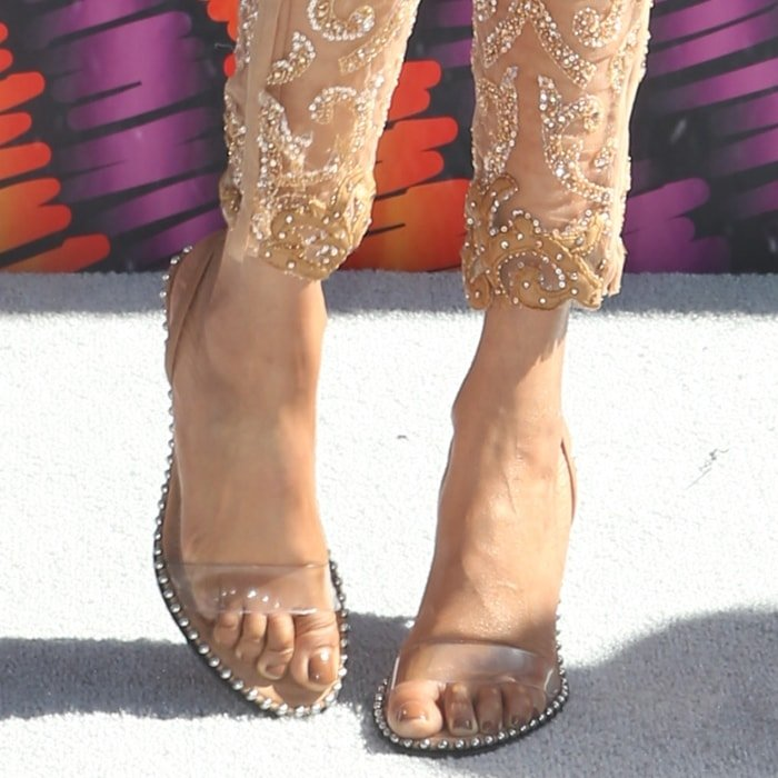 Tyra Banks shows off her feet in Alexander Wang sandals