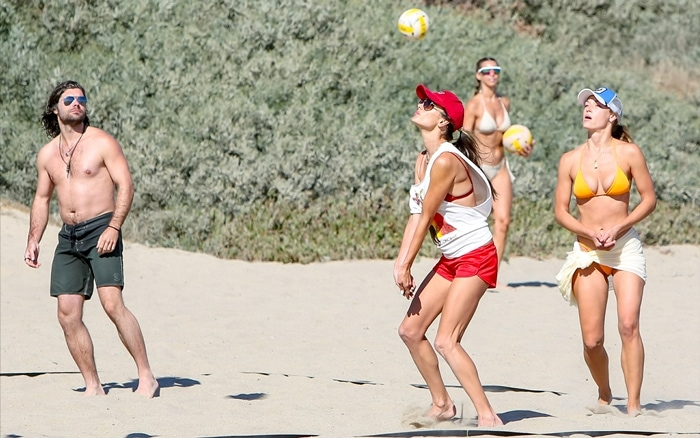 Alessandra Ambrosio spends the day at the beach, playing beach volleyball and hanging out with friends in Malibu
