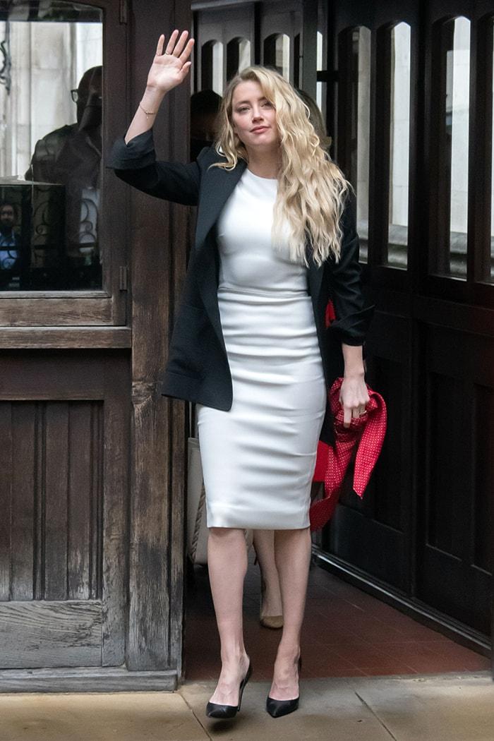 Amber Heard wears a white Victoria Beckham sheath dress on July 27, 2020