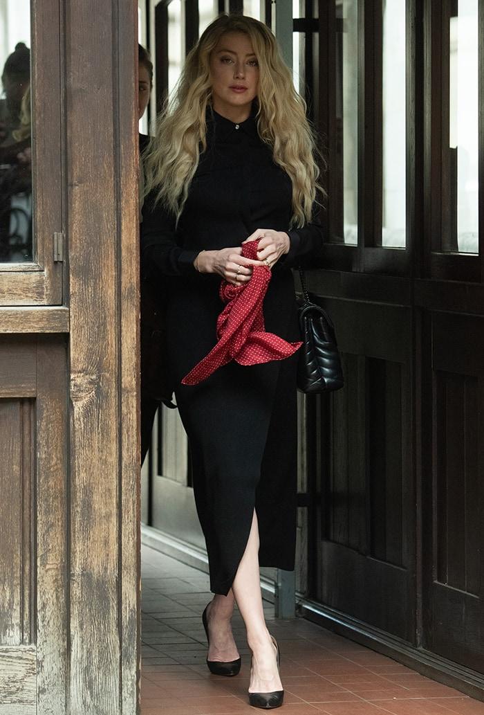 Amber Heard tucks her black Saint Laurent shirt into a black Joseph crepe skirt