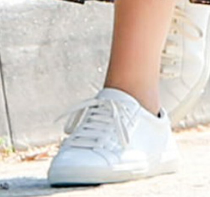 Ana de Armas completes her dog-walking look with Saint Laurent white sneakers