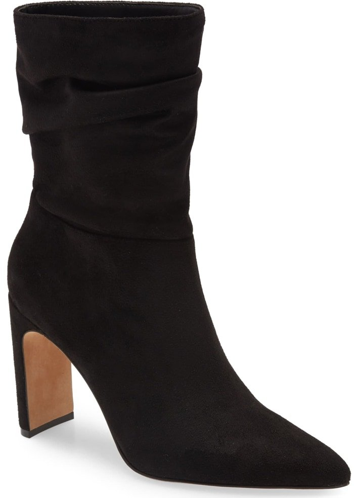 A bit of slouchiness at the cuff brings ease to this black bootie set on a sleek yet sturdy, half-moon-shaped heel