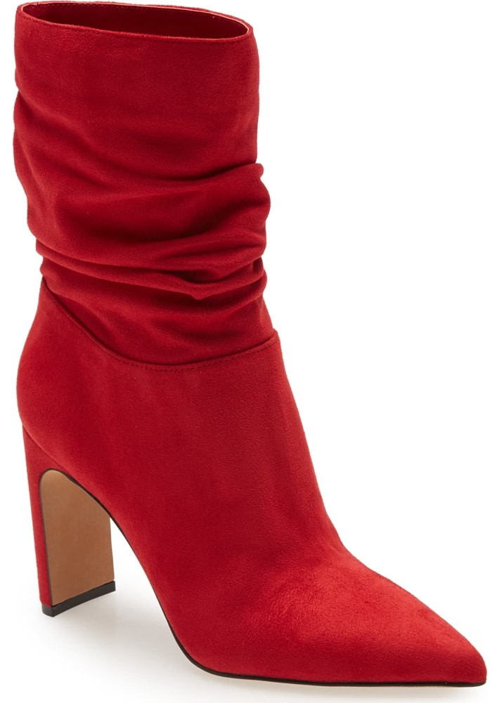 A bit of slouchiness at the cuff brings ease to this red bootie set on a sleek yet sturdy, half-moon-shaped heel