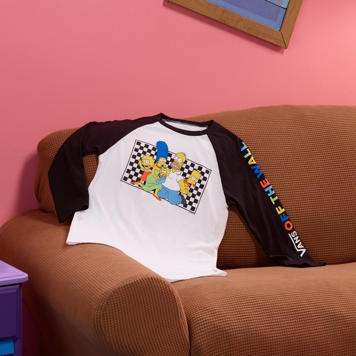 Stylish shirt with a checkerboard Simpson family portrait at the chest, colorful Vans graphics at the left sleeve, and contrast raglan details