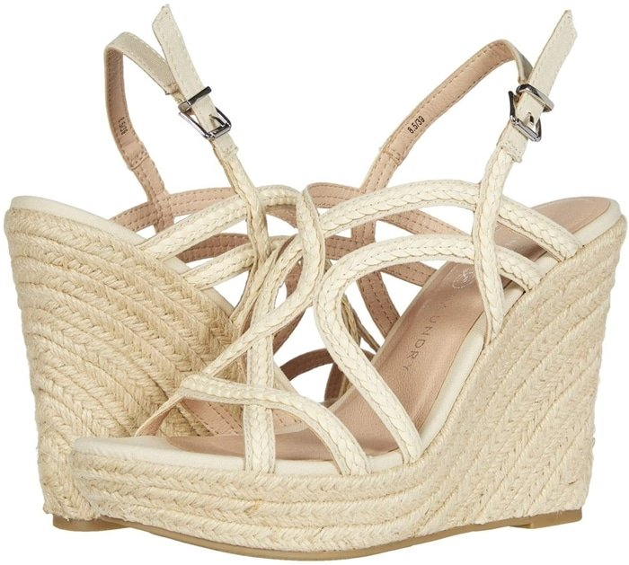 Channel some seaside sass in this cream slingback sandal with braided straps and jute wrapping its towering wedge heel and platform