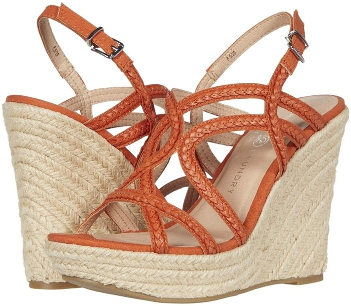Channel some seaside sass in this orange fabric slingback sandal with braided straps and jute wrapping its towering wedge heel and platform