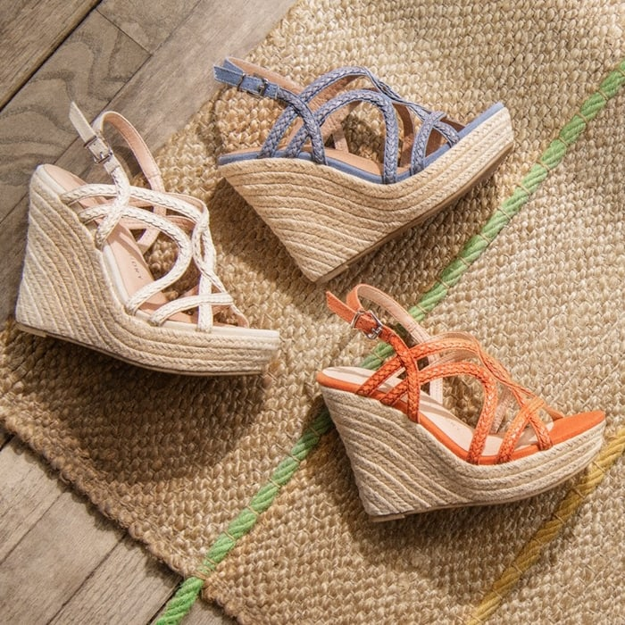 Channel some seaside sass in this slingback sandal with braided straps and jute wrapping its towering wedge heel and platform