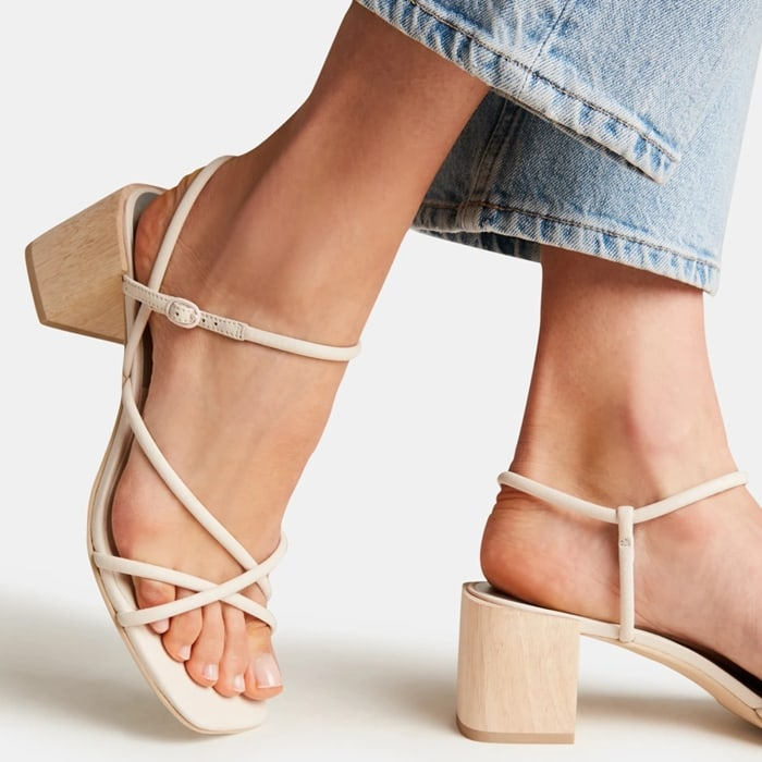 A blocky wood heel and squared-off toe bring on-trend geometries to a strappy sandal that serves as a go-to warm-weather style