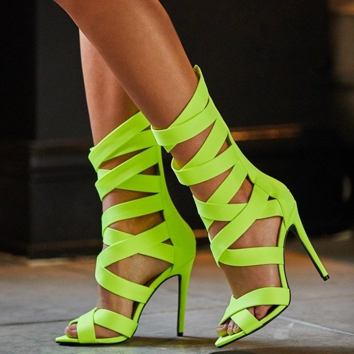 A strappy stiletto-heeled sandal with a zipper closure