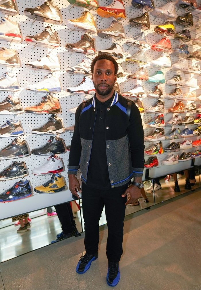 Football wide receiver Anquan Boldin checks out sneakers at Flight Club, a New York-based sneaker consignment marketplace that was acquired by GOAT in 2018