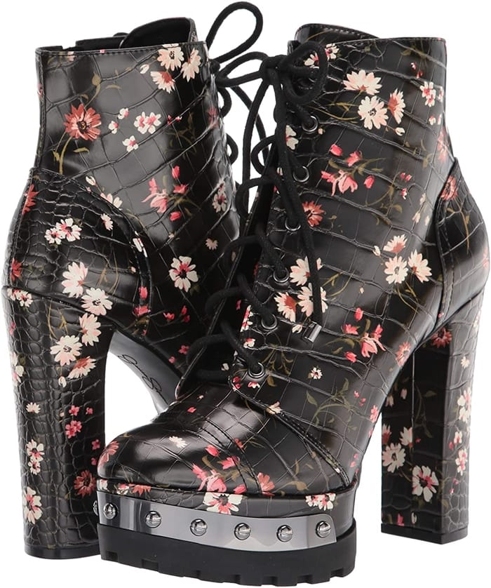 Nail-head studs highlight the platform sole of this black floral style-savvy version of a classic combat boot