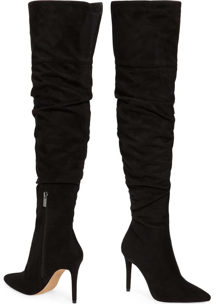 A slender stiletto lifts these black knee-high boots that are relaxed through the calf with a bit of slouchiness