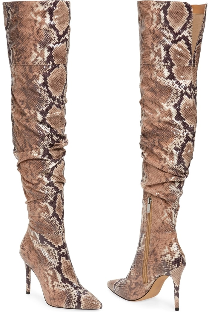 A slender stiletto lifts these snake print knee-high boots that are relaxed through the calf with a bit of slouchiness