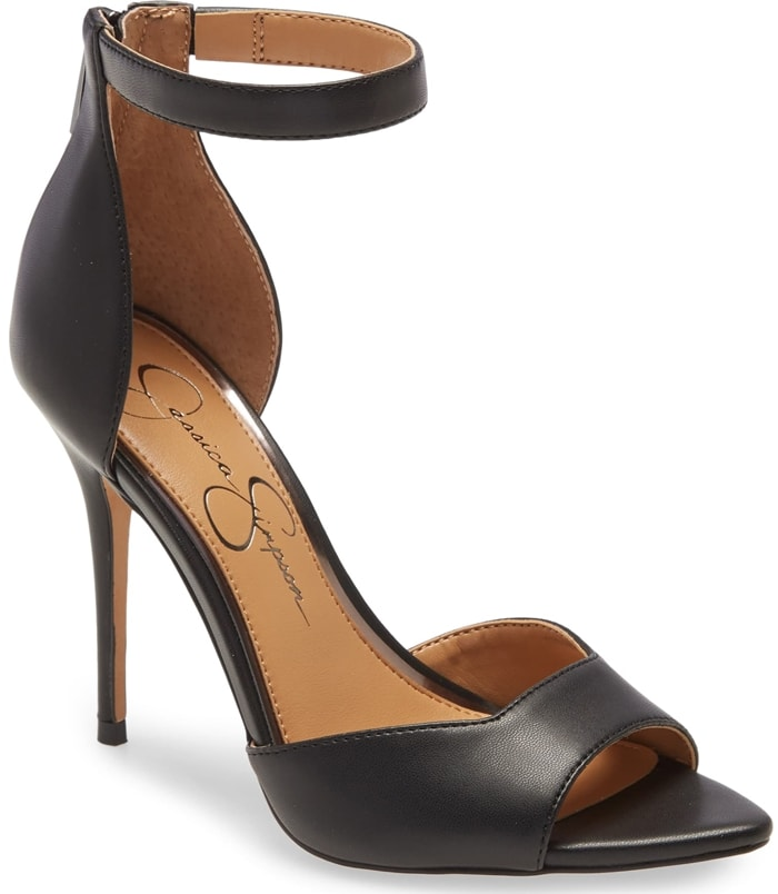 A pointed toe and squared strap create sleek, sharp angles on this sandal set on a sky-high stiletto