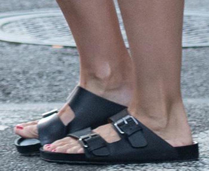 Katie Holmes slips her feet into a pair of Birkenstock Arizona premium sandals