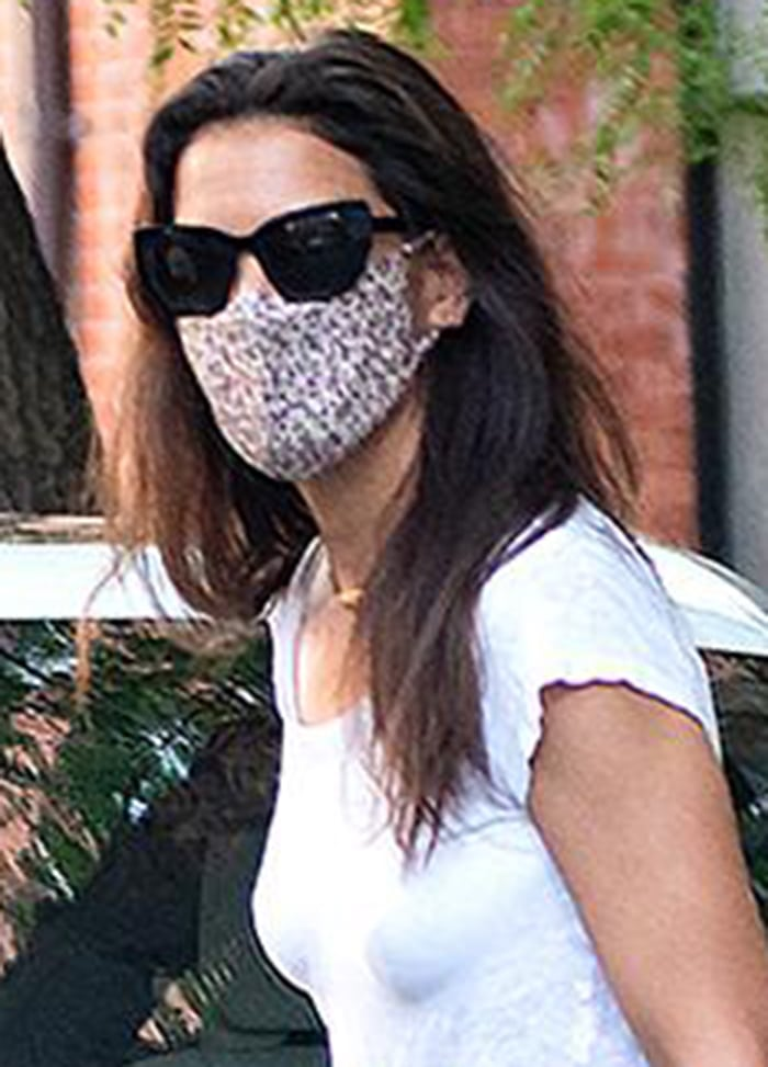 Katie Holmes wears Prada sunnies with a printed face mask