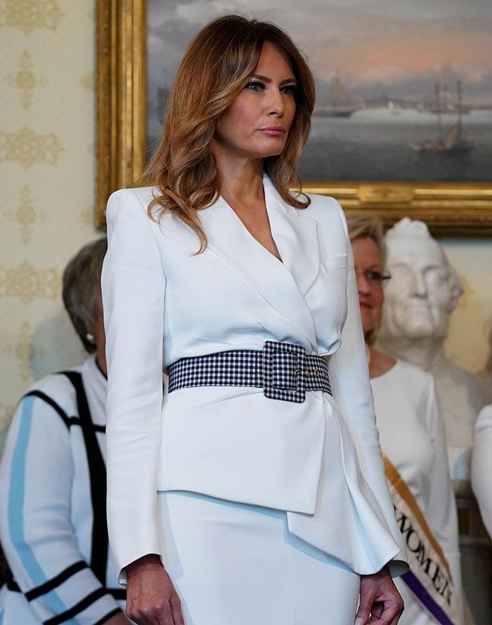 Melania Trump teams a Michael Kors Spring 2018 blazer with a Spring 2017 pencil skirt