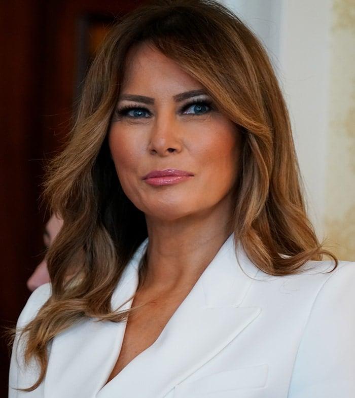 Melania Trump wears her signature smokey eye-makeup and loose brown tresses