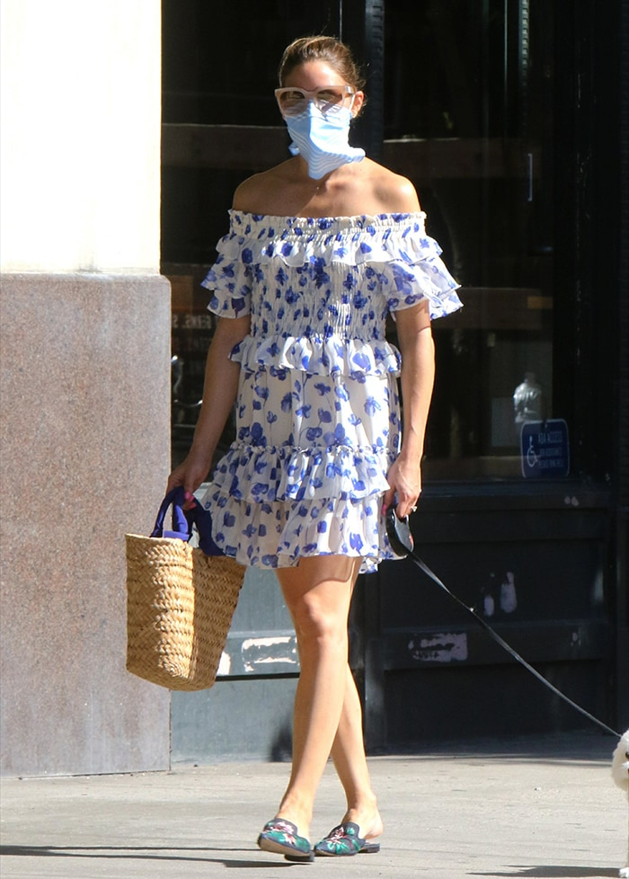 Olivia Palermo parades her slim legs in a New Look white and blue floral dress