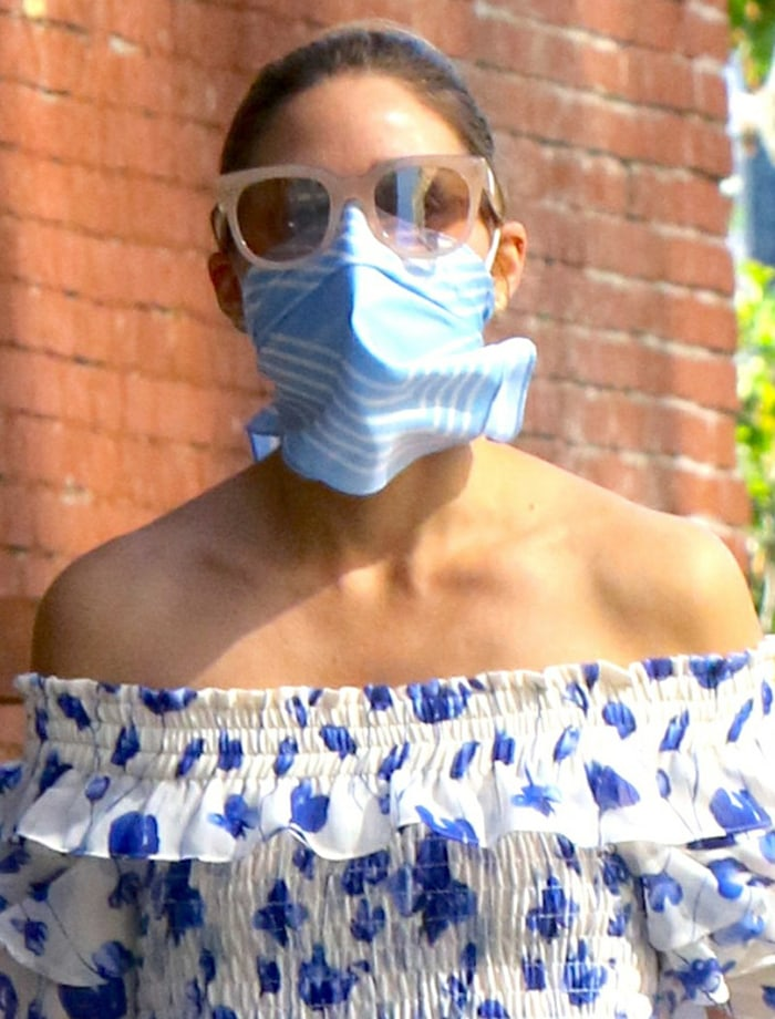 Olivia Palermo adheres to CDC safety guidelines with a light blue handkerchief as a face covering