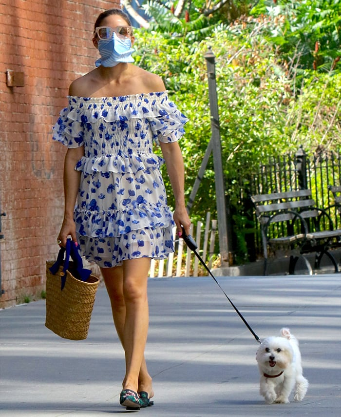 Olivia Palermo walks Mr. Butler in a summer floral dress in New York City